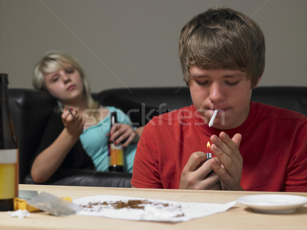 Stock photo: Teenage Couple Taking Drugs At Home