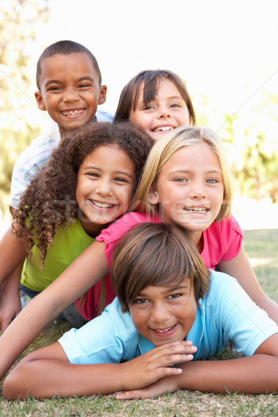 Group Of Children Piled Up In Park Stock photo © monkey_business