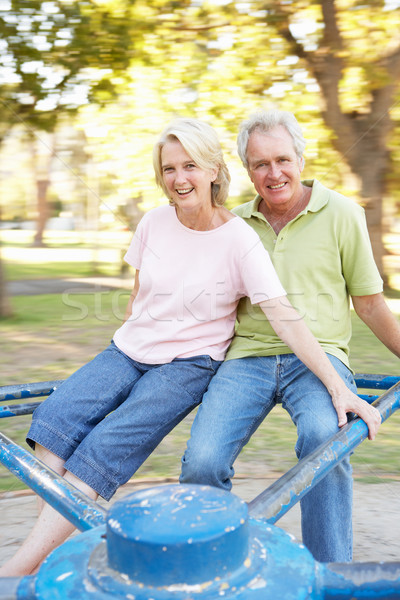 Senior Couple Riding On Roundabout In Park Stock photo © monkey_business