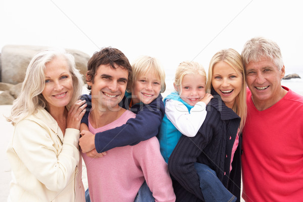 Close Up Of Three Generation Family On Winter Beach Stock photo © monkey_business