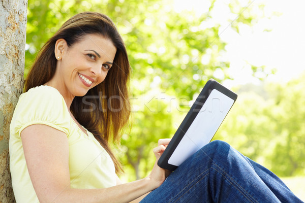 Kadın tablet açık havada iş çim çalışmak Stok fotoğraf © monkey_business