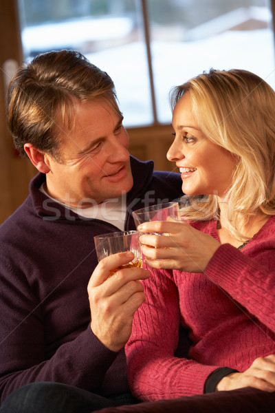 Middle Aged Couple Sitting On Sofa With Glasses Of Whisky Stock photo © monkey_business