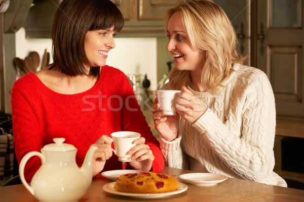 Two Middle Aged Women Enjoying Tea And Cake Together Stock photo © monkey_business