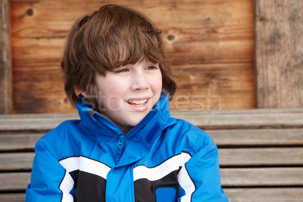 Boy Dressed For Cold Weather Sitting On Wooden Bench Stock photo © monkey_business