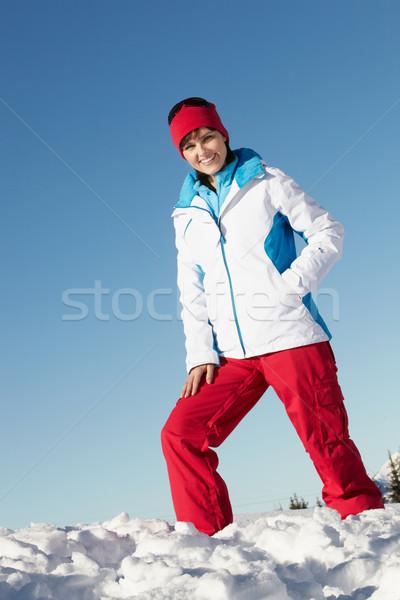 Mujer pie nieve caliente ropa Foto stock © monkey_business