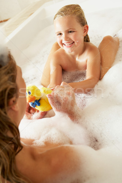 Mother And Daughter Relaxing In Bubble Filled Bath Stock photo © monkey_business