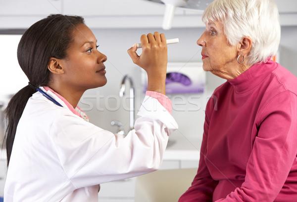 Orvos megvizsgál idős női szemek nők Stock fotó © monkey_business