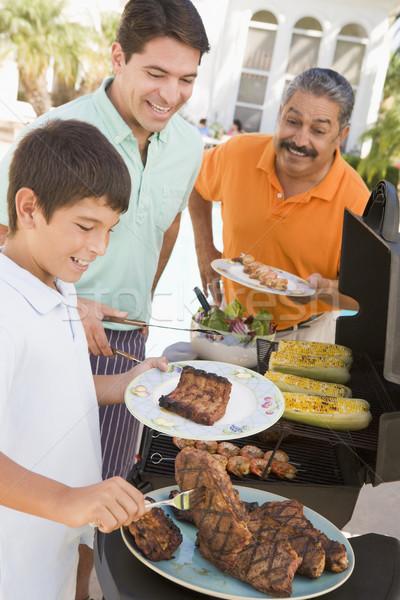 Family Enjoying A Barbeque Stock photo © monkey_business