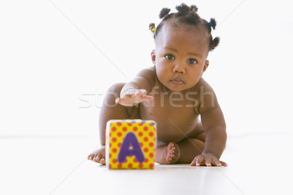 Baby playing with block Stock photo © monkey_business
