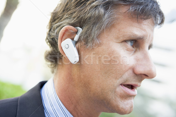 Businessman wearing earpiece outdoors Stock photo © monkey_business