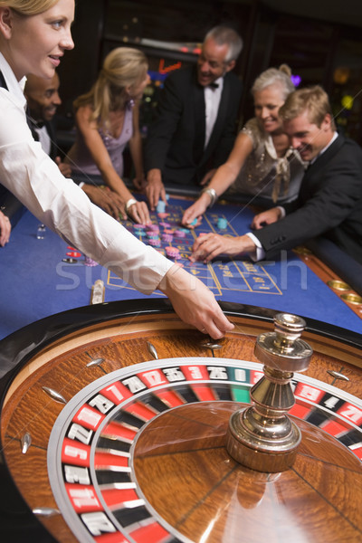 Group of friends gambling in casino Stock photo © monkey_business