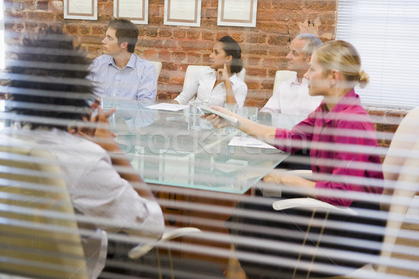 Five businesspeople in boardroom through window Stock photo © monkey_business