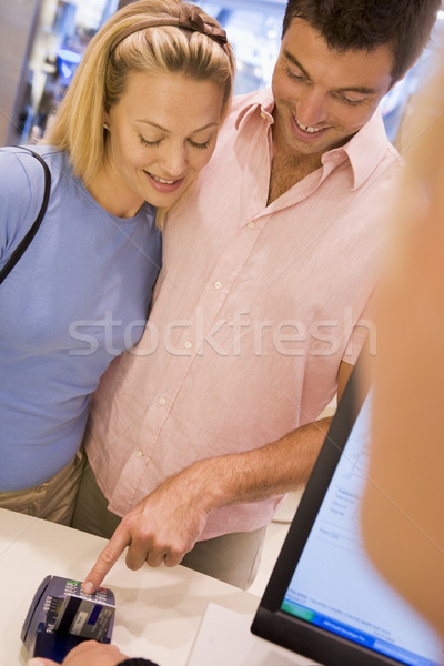 Couple making purchase in store Stock photo © monkey_business