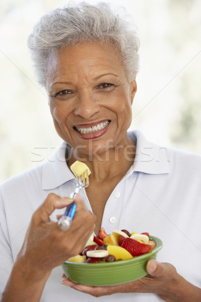 Senior Adult Eating A Fresh Fruit Salad Stock photo © monkey_business
