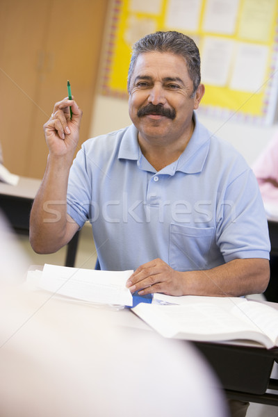 Mature male student raising hand in class Stock photo © monkey_business