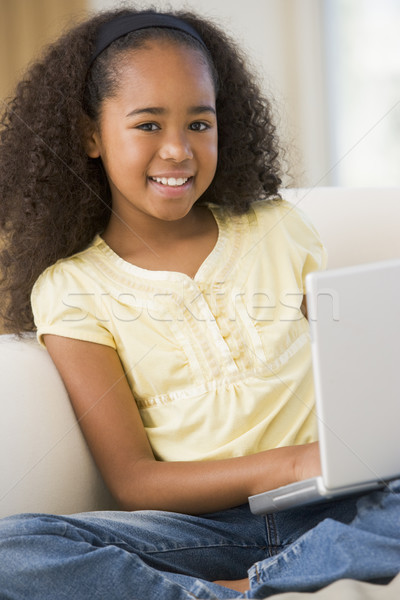 Young Girl Sitting On A Sofa, Using A Laptop Stock photo © monkey_business