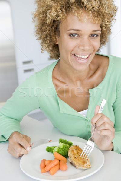 Donna mangiare sano mangiare sorridere vegetali colore Foto d'archivio © monkey_business