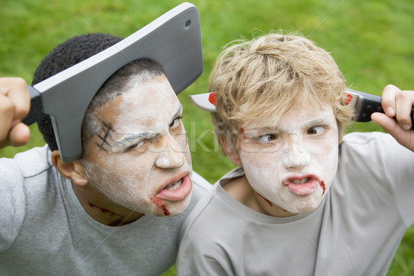 Two young boys with scary Halloween make up and plastic knives t Stock photo © monkey_business