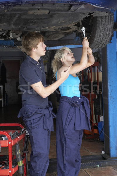 Mechanic and apprentice working on car Stock photo © monkey_business