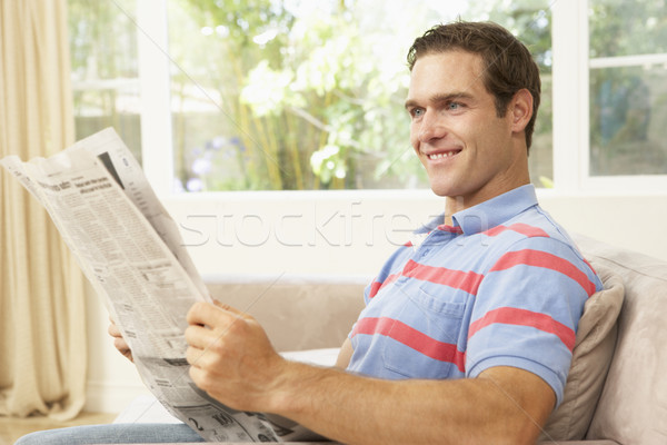 Stock fotó: Férfi · olvas · újság · otthon · boldog · portré