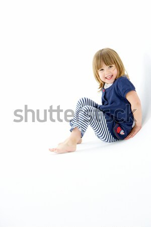 Young Girl Sitting In WhiteStudio Stock photo © monkey_business