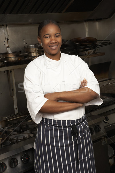 Female Chef Standing Next To Cooker In Restaurant Kitchen Stock photo © monkey_business