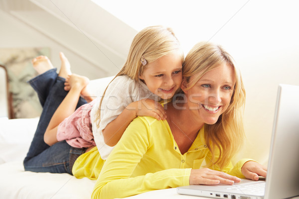 Mother And Daughter Using Laptop Relaxing Sitting On Sofa At Hom Stock photo © monkey_business