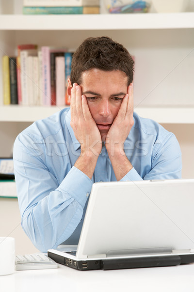 Worried Looking Man Working From Home Using Laptop Stock photo © monkey_business