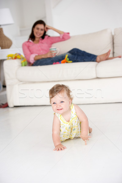 Mother watching baby crawl Stock photo © monkey_business