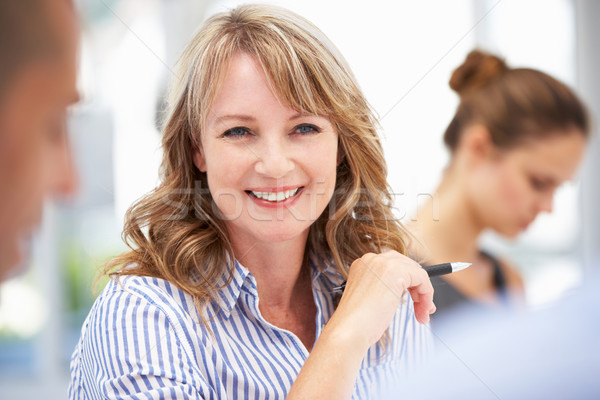 Mid age businesswoman in meeting Stock photo © monkey_business
