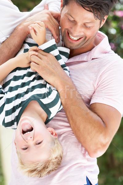Pai filho de cabeça para baixo ao ar livre crianças Foto stock © monkey_business
