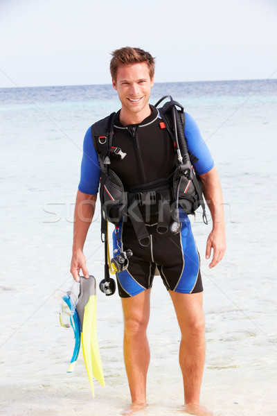 Man With Scuba Diving Equipment Enjoying Beach Holiday Stock photo © monkey_business