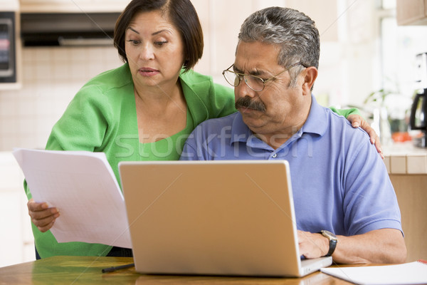 Pareja cocina portátil papeleo ordenador mujer Foto stock © monkey_business