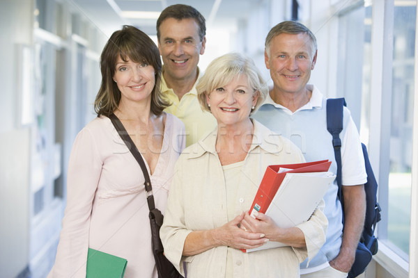 A group of adult students with backpacks standing in a campus co Stock photo © monkey_business