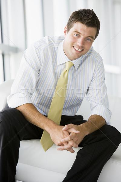 üzletember ül iroda lobbi mosolyog férfi Stock fotó © monkey_business