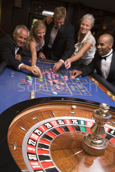 Group of friends of gambling in casino Stock photo © monkey_business