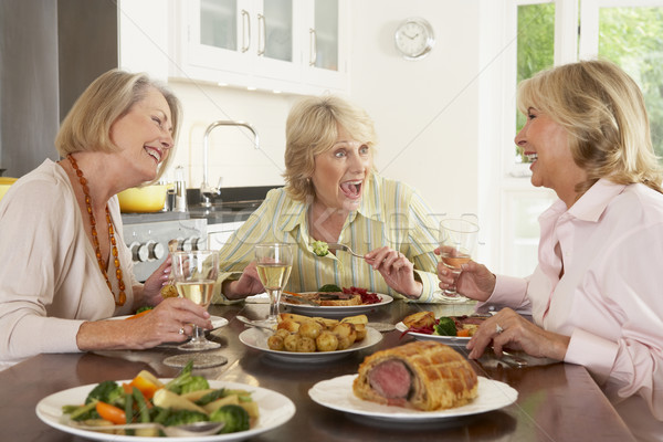 Stock photo: Friends Enjoying Lunch At Home Together