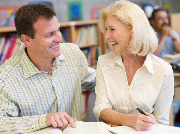 Mature student laughing with tutor in library Stock photo © monkey_business