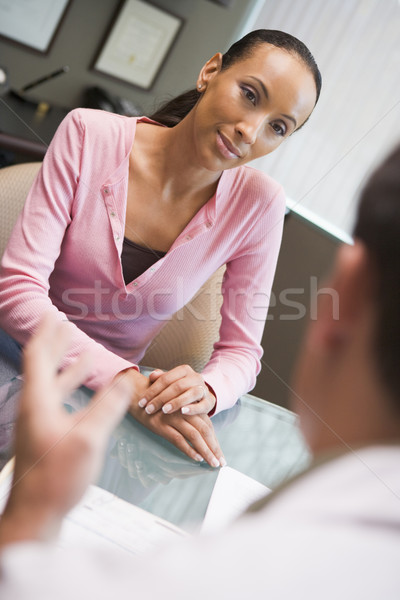 Stock photo: Woman having meeting with doctor in IVF clinic