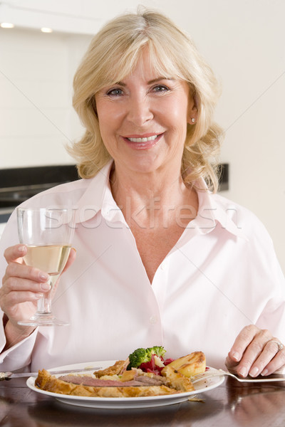Women Enjoying meal,mealtime With A Glass Of Wine  Stock photo © monkey_business