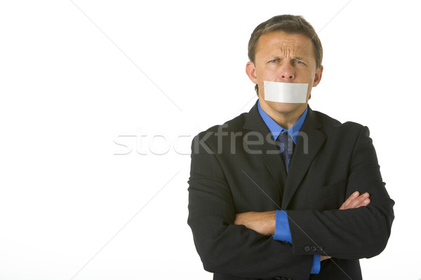 Stock photo: Businessman With His Arms Folded  And His Mouth Taped Shut