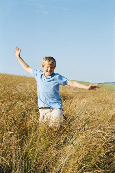 Young boy running outdoors smiling Stock photo © monkey_business