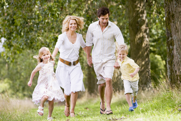 Family running on path holding hands smiling Stock photo © monkey_business