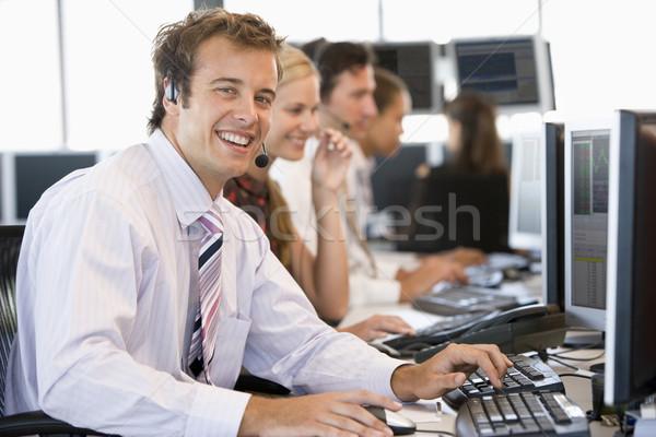 在庫 トレーダー 笑みを浮かべて カメラ コンピュータ ビジネスマン ストックフォト © monkey_business