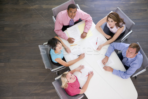 Five businesspeople at boardroom table Stock photo © monkey_business