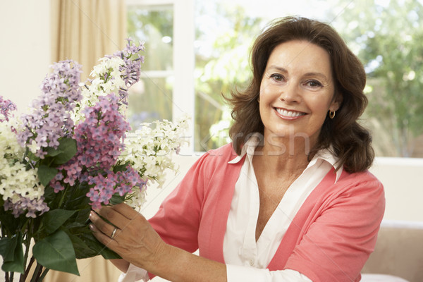 Idős nő otthon virágok virág boldog Stock fotó © monkey_business