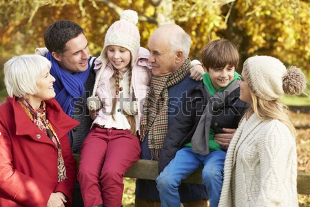 Stock photo: Group Of Four Teenage Girls Taking Picture With Camera Sitting O