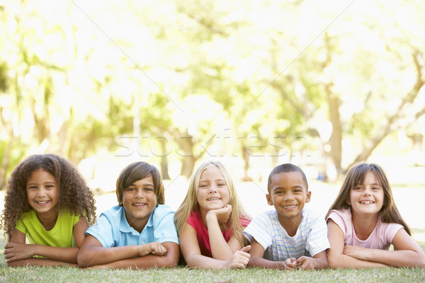 Group Of Children Lying On Stomachs In Park Stock photo © monkey_business