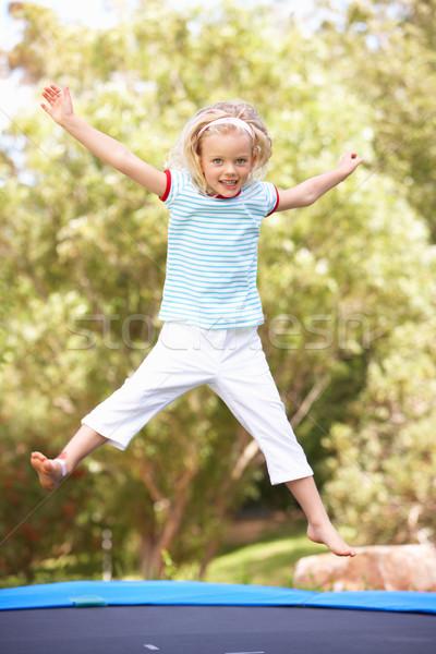 Jovem saltando trampolim jardim menina retrato Foto stock © monkey_business