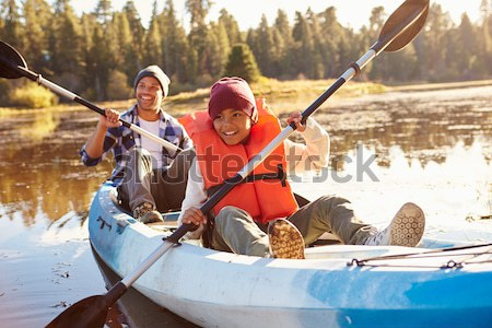 Family Group Sitting On Boat With Fishing Rod On Winter Beach Stock photo © monkey_business